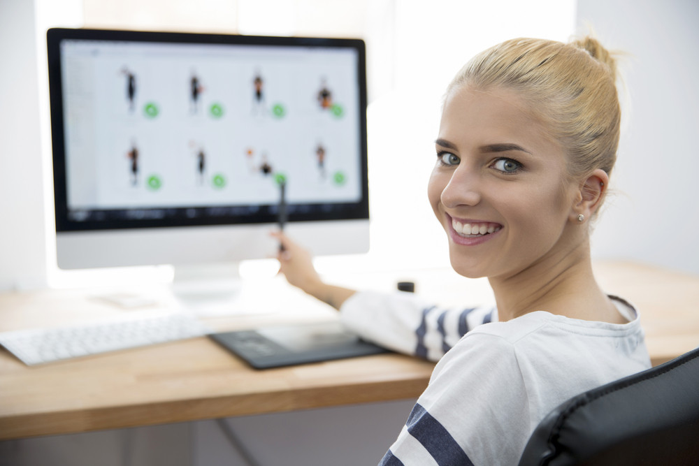 Female photo editor working on computer