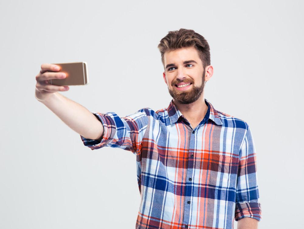 Man making selfie photo on smartphone