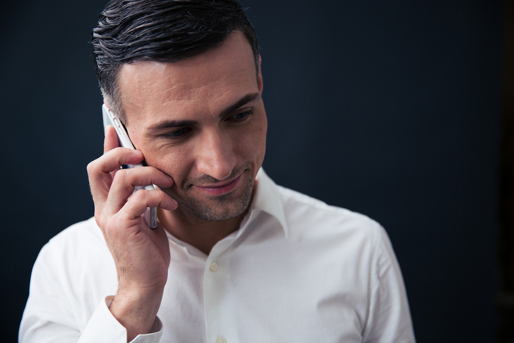 Happy businessman talking on the phone
