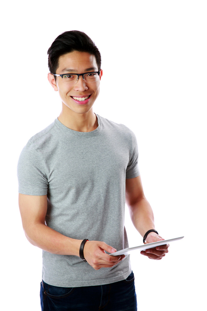 Asian man standing with tablet computer over white background