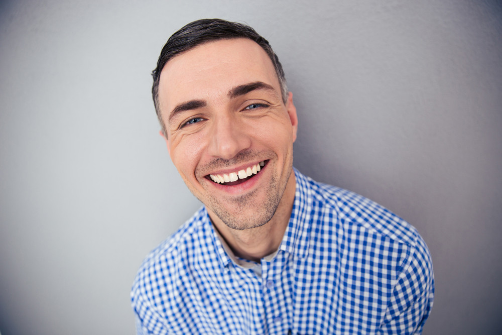 Portrait of a cheerful man looking at camera