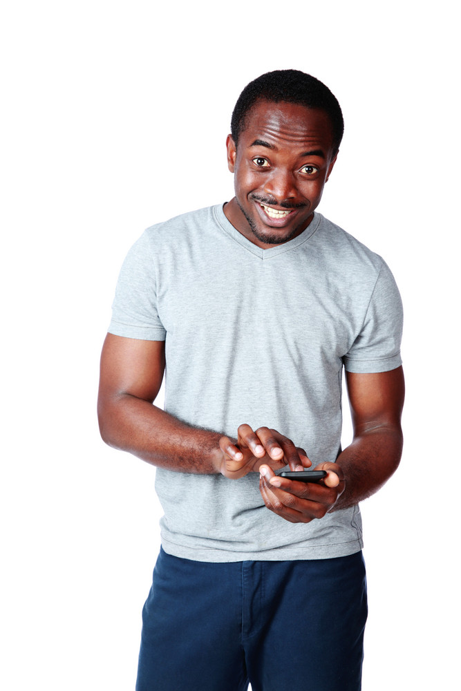 Portrait of a happy african man using smartphone over white background