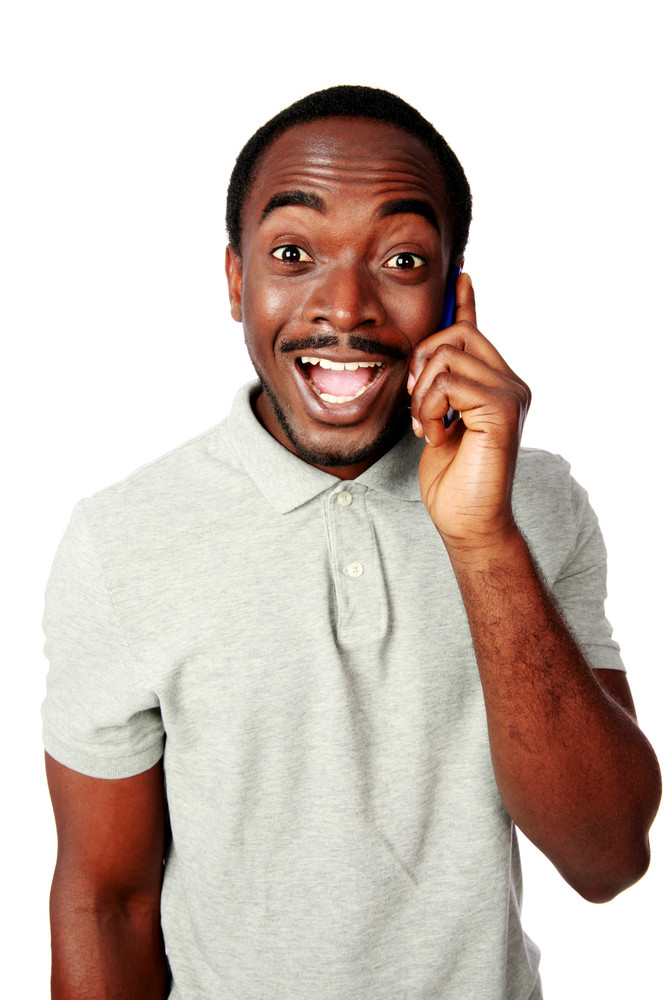 Funny african man talking on the phone isolated on a white background