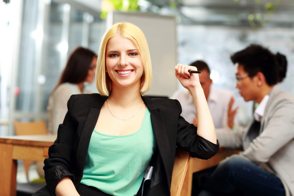 Portrait of a smiling businesswoman in office