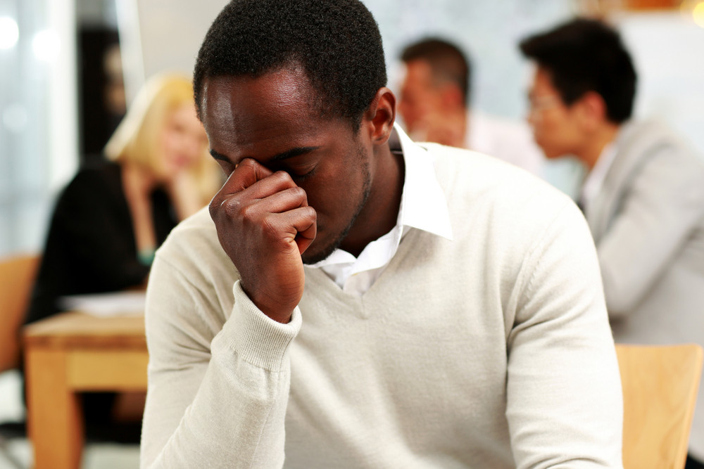 African American businessman tired in office