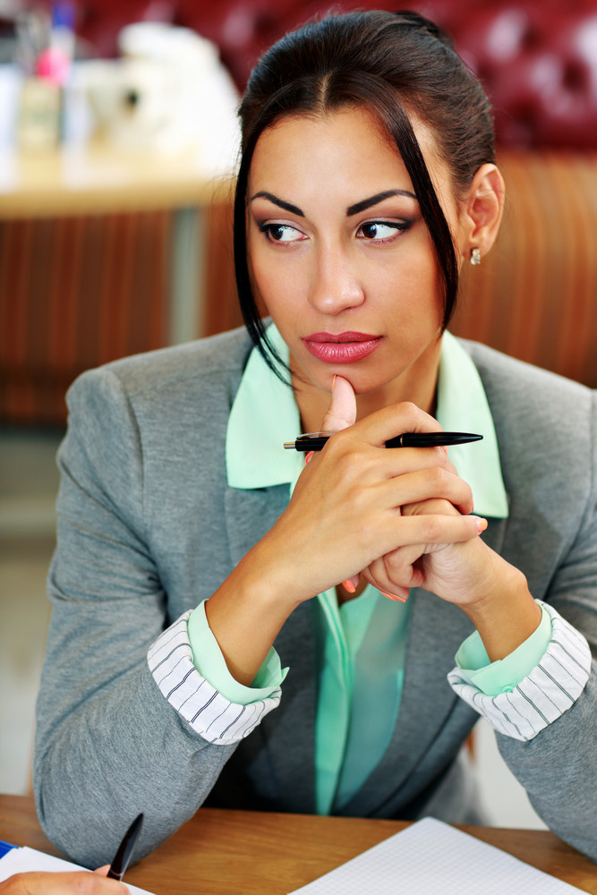Portrait of a pensive businesswoman looking away in office