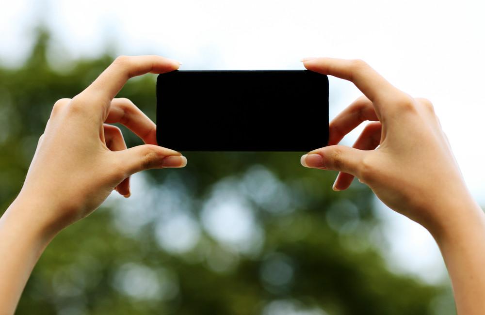 Closeup portrait of a female hands holding smartphone