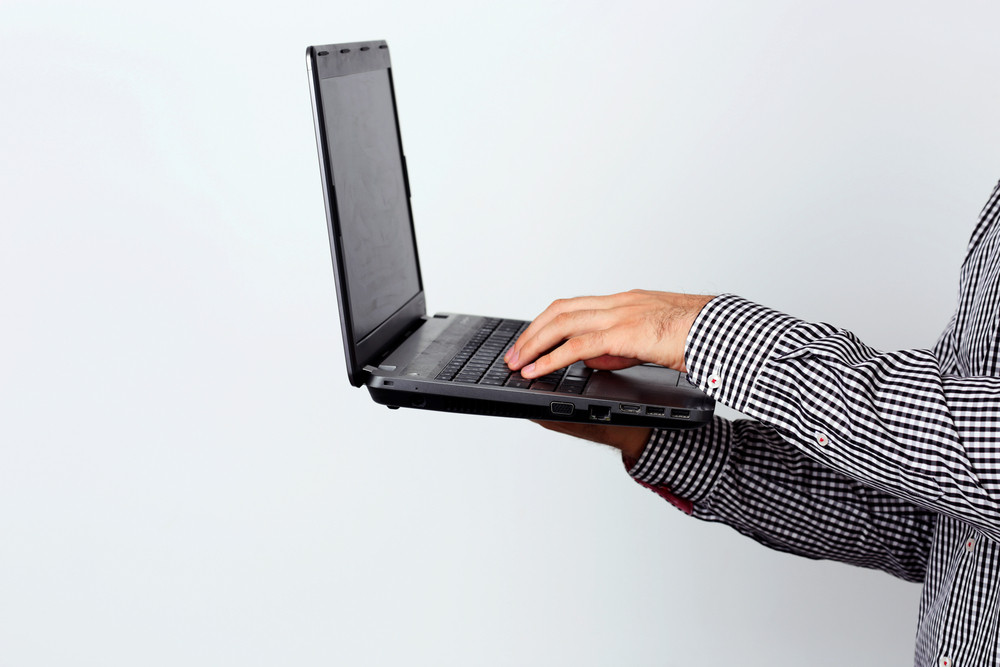 Side view portrait of a man using laptop