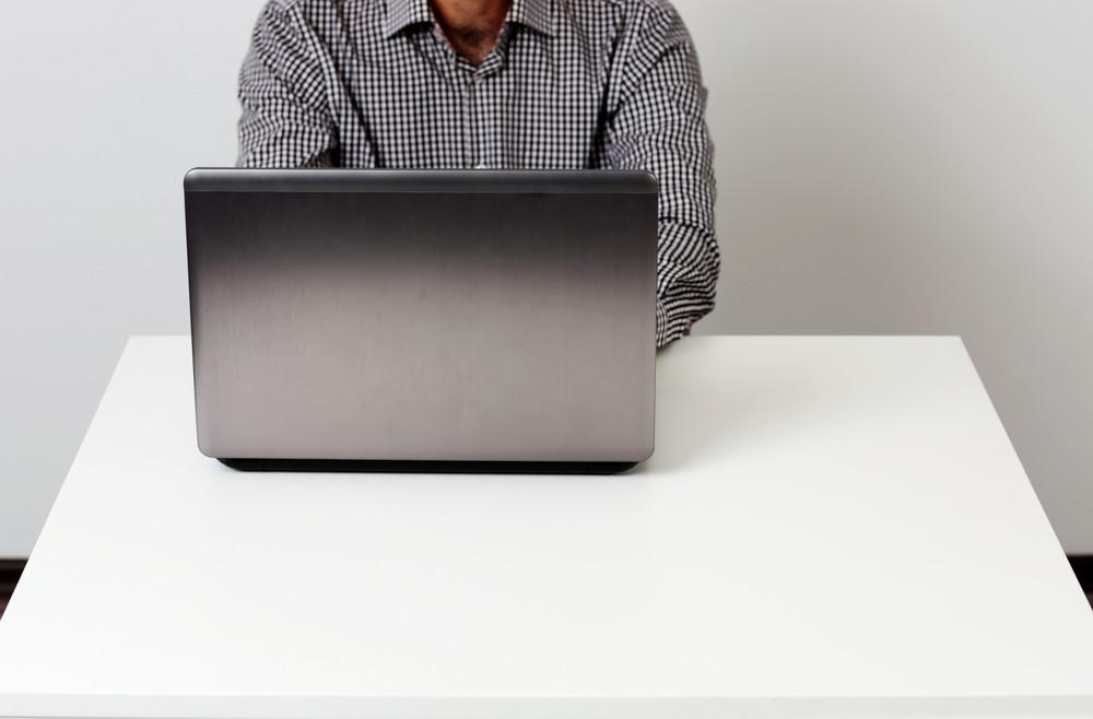 Closeup portrait of a businessman working on the laptop
