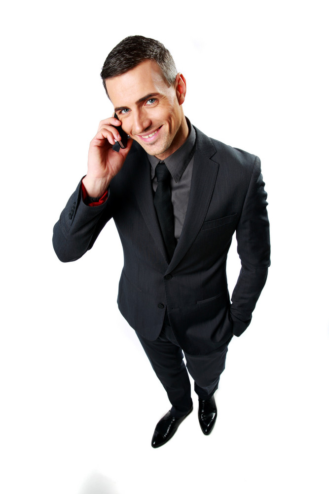 Happy businessman speaking on cell phone isolated on a white background
