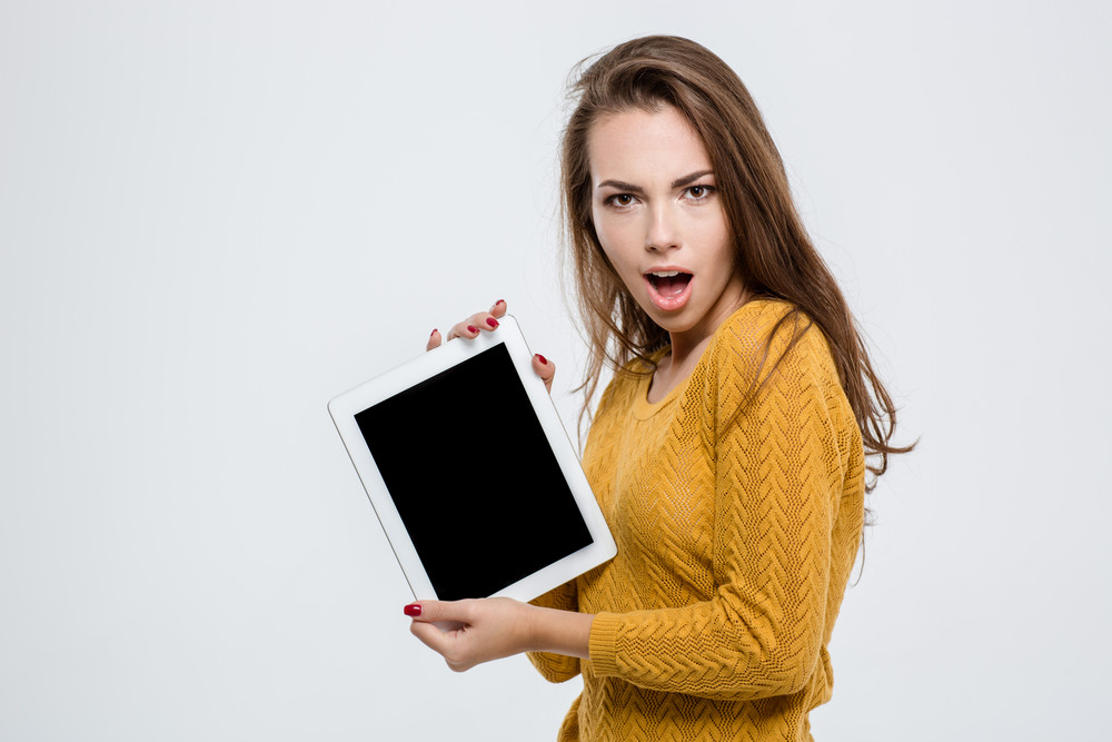 Woman showing blank tablet computer screen