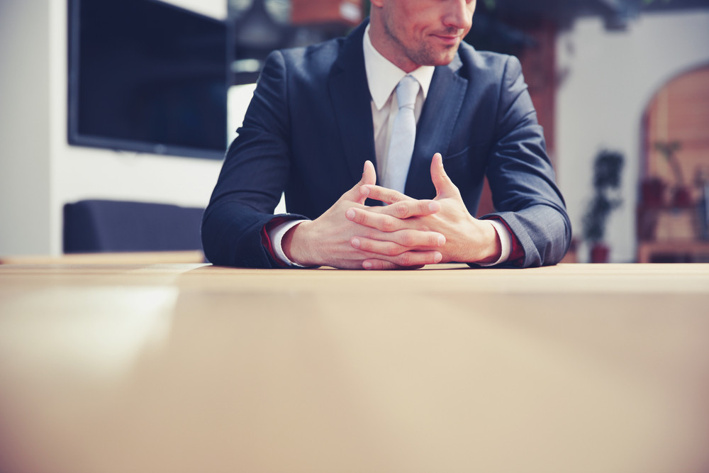 Portrait of a businessman sitting at office