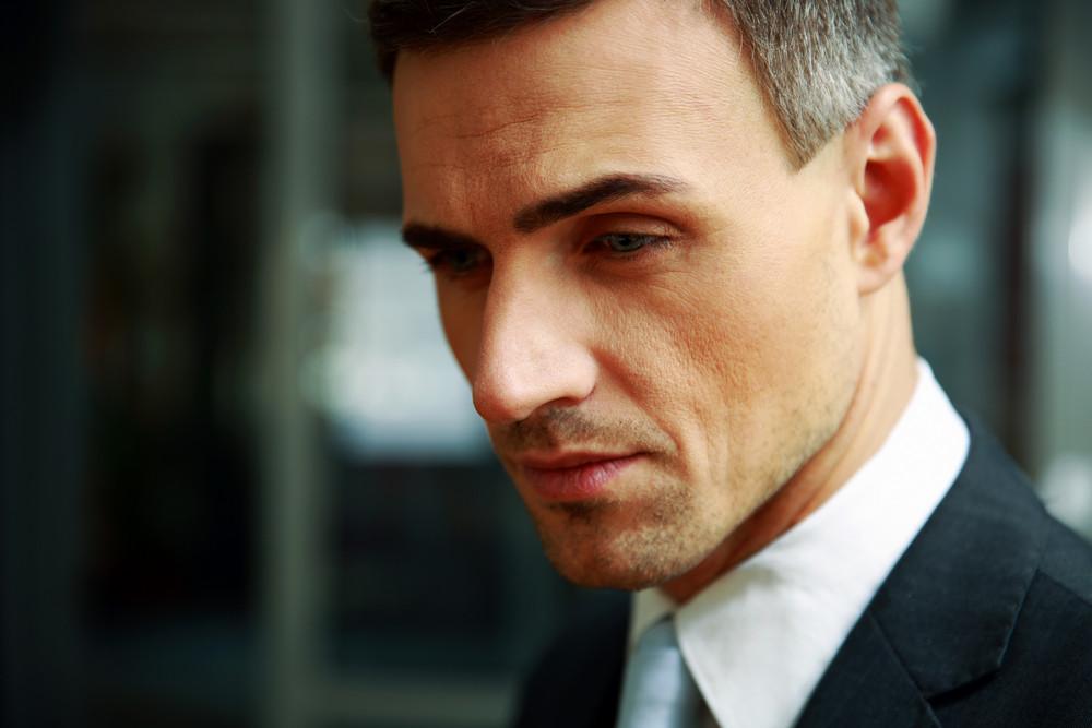 Closeup portrait of a pensive businessman