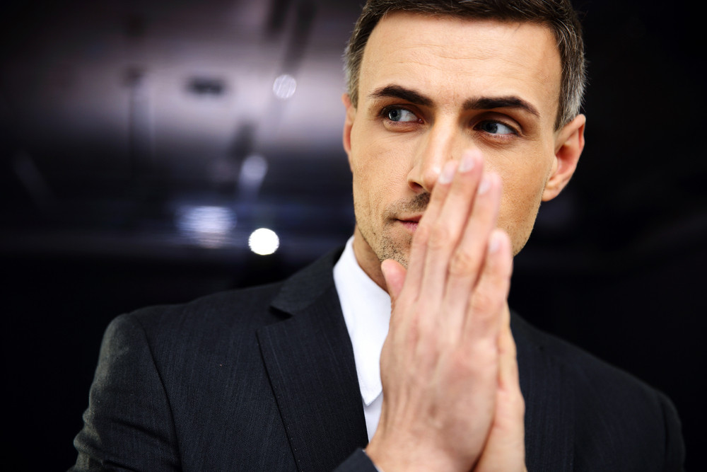 Portrait of a pensive businessman looking away in office