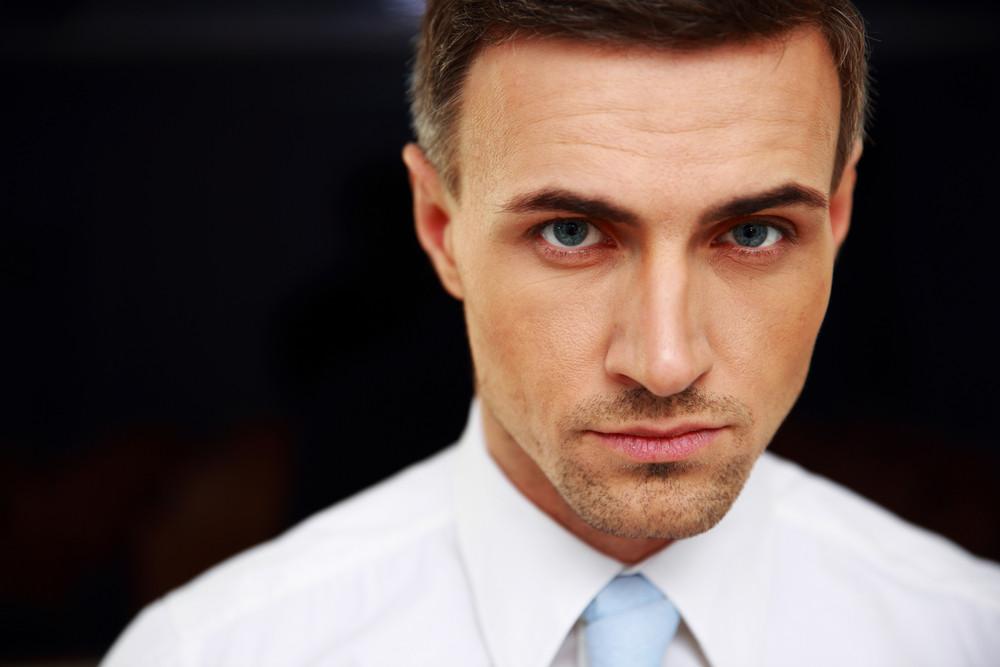 Closeup portrait of a confident businessman