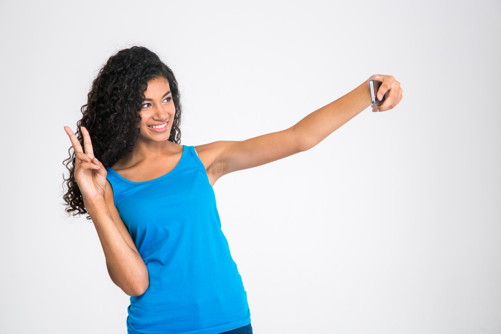 Happy afro american woman making selfie photo