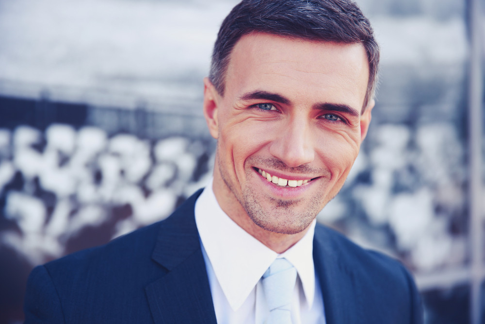 Portrait of a happy handsome businessman in suit