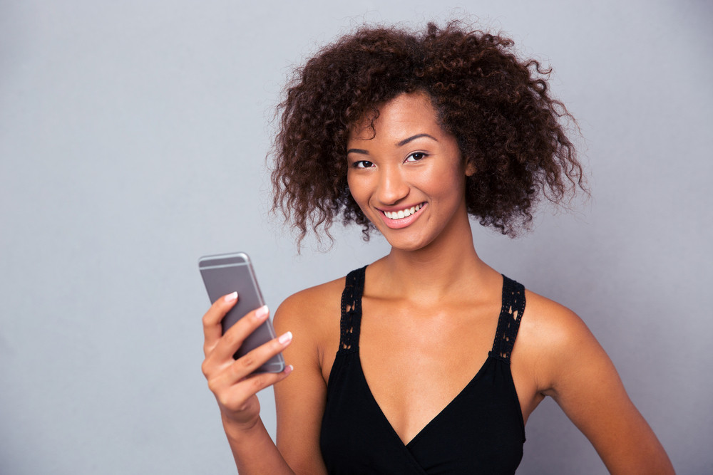 Afro american woman using smartphone