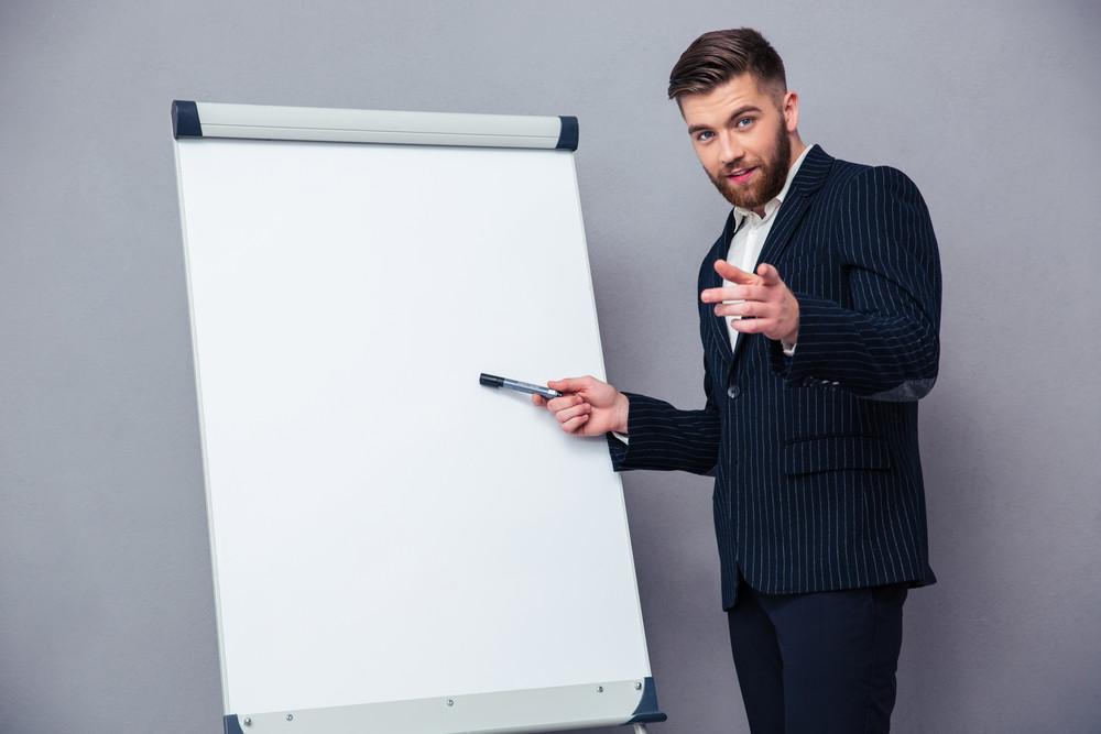 Businessman presenting something on blank board