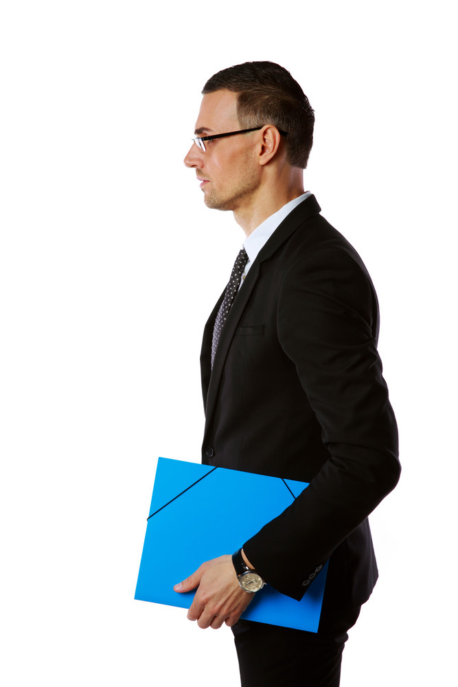 Side view portrait of a businessman in glasses with blue folder over white background
