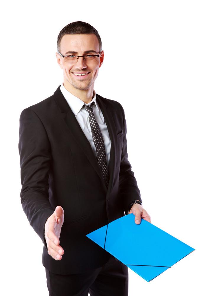 Handsome businessman offering handshake over white background