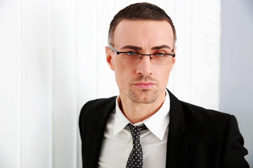 Portrait of a confident businessman in glasses