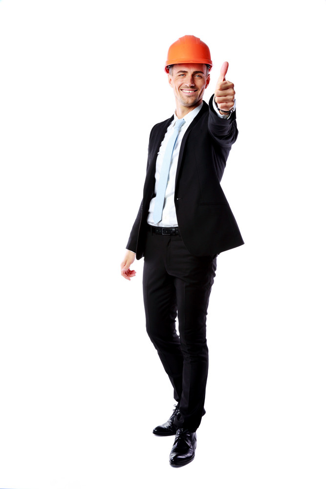 Businessman in helmet giving thumbs up over white background