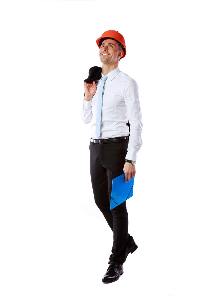 Happy businessman in helmet with blue folder over white background