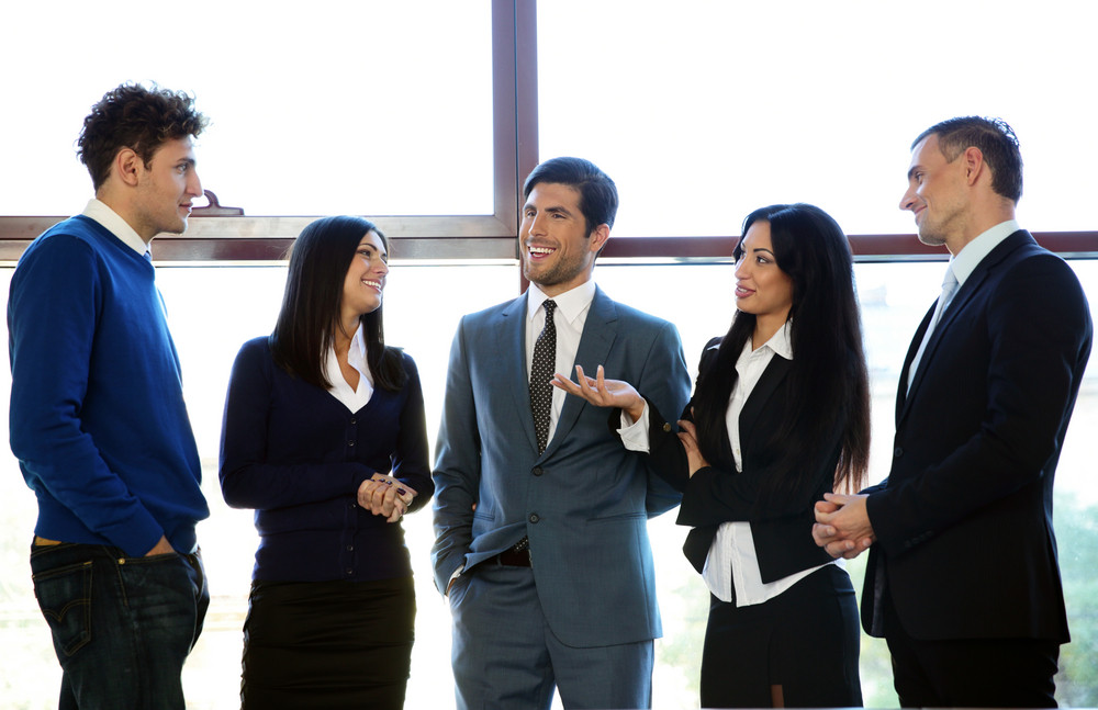 Group of business people talking in the office