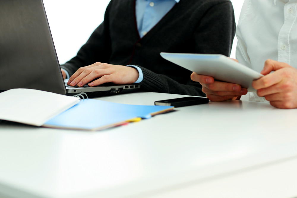 Businesspeople working in office at the table