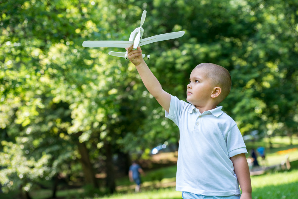 Boy with airplane toy