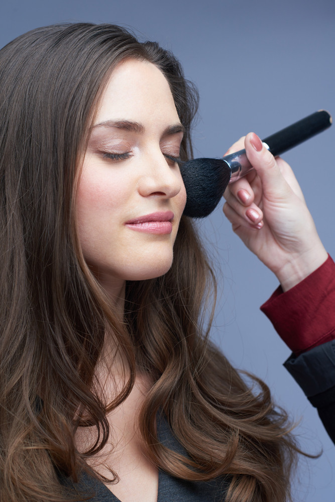 Woman Getting Makeup Applied