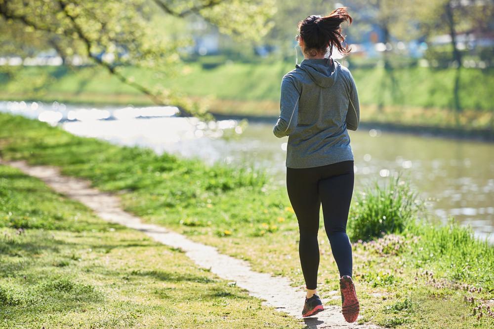 Woman jogging in park at morning