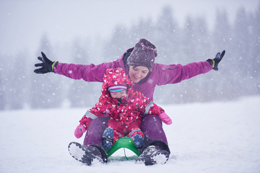 Família feliz em férias do inverno