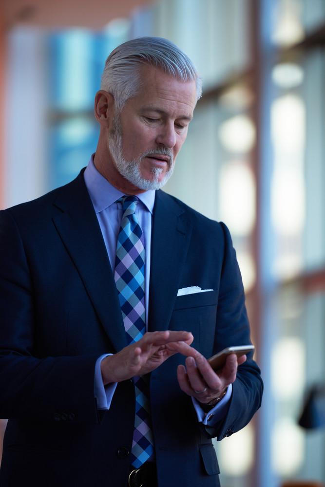 Senior Business Man Talk On Mobile Phone