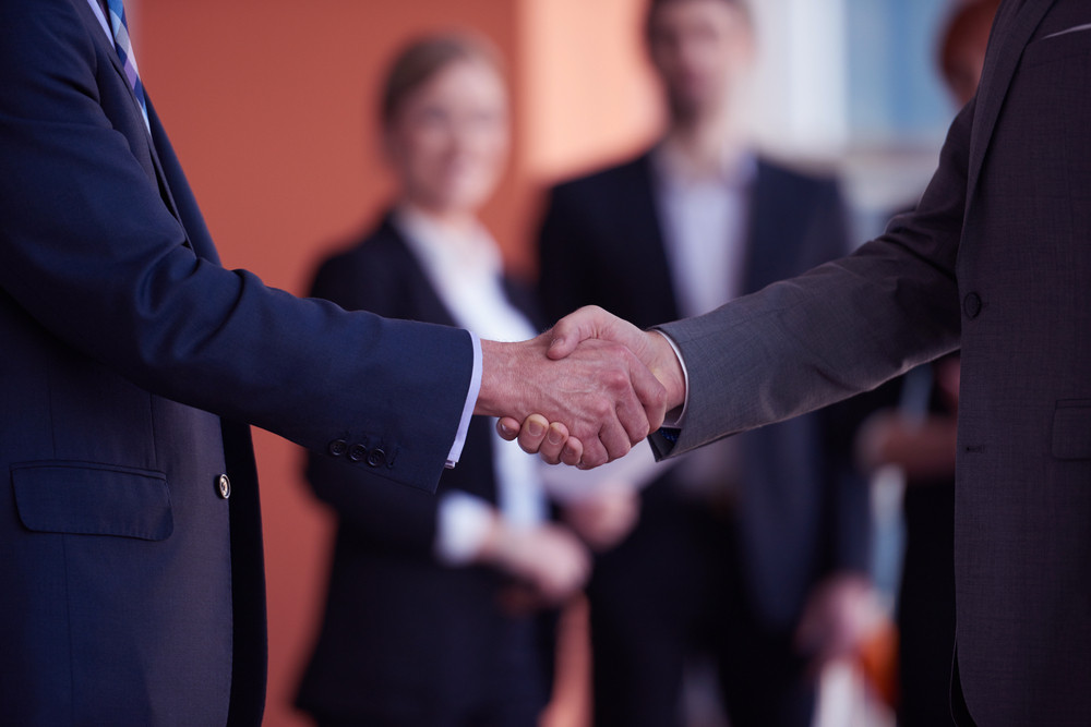 Partnership Concept With Two Business Man Handshake