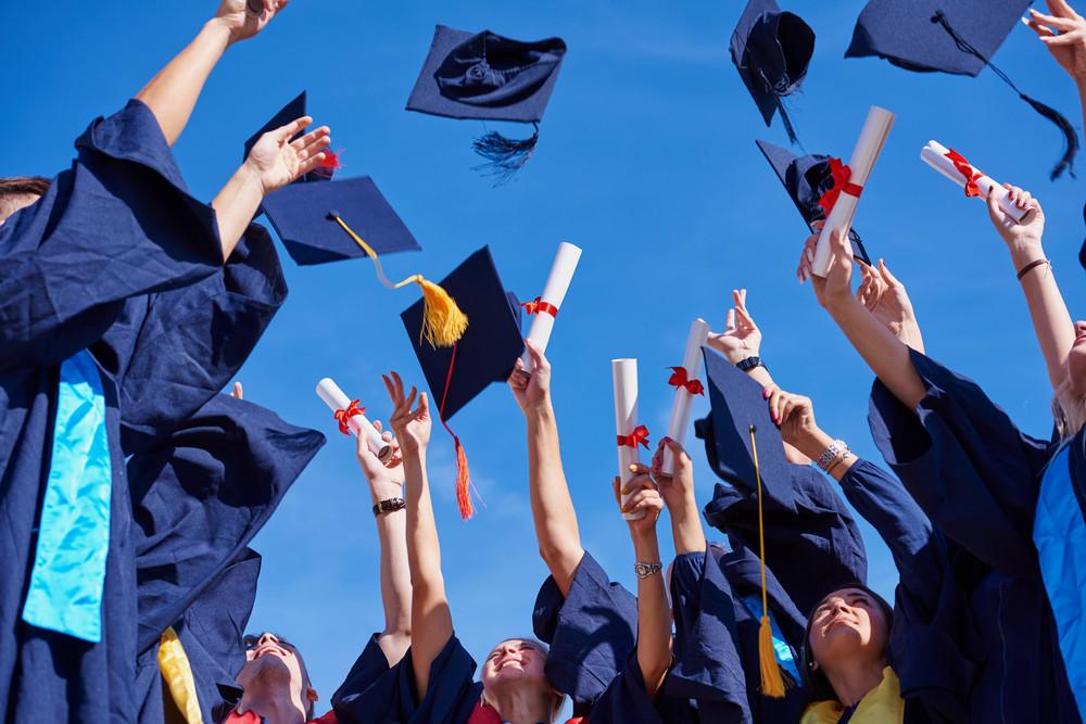 Young graduates celebrating
