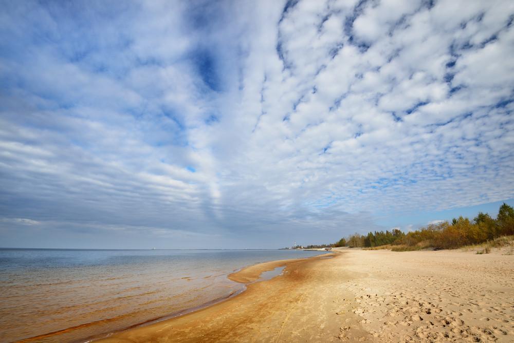 Baltic Sea Shore And Ornamental Clouds In Riga
