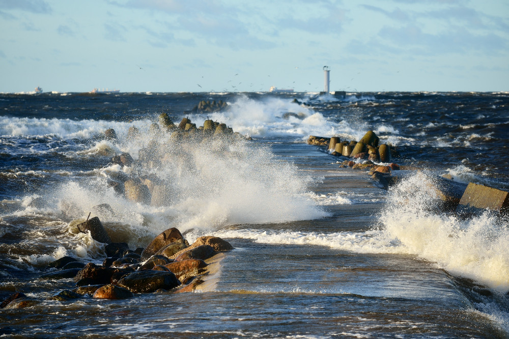 Big And Powerful Sea Waves And A Lighthouse During The Storm