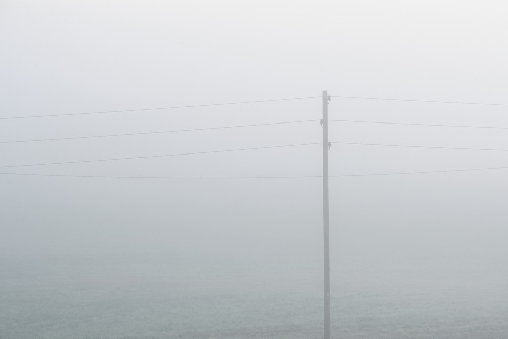 Lonely Electricity Cable Line In Strong Fog