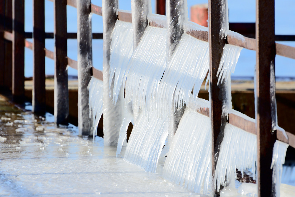 Group Of Icicles On The Pier In Winter