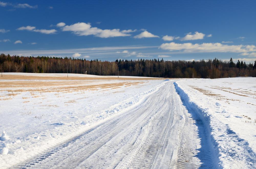 Classic Winter Scene Of A Road In Rural Area