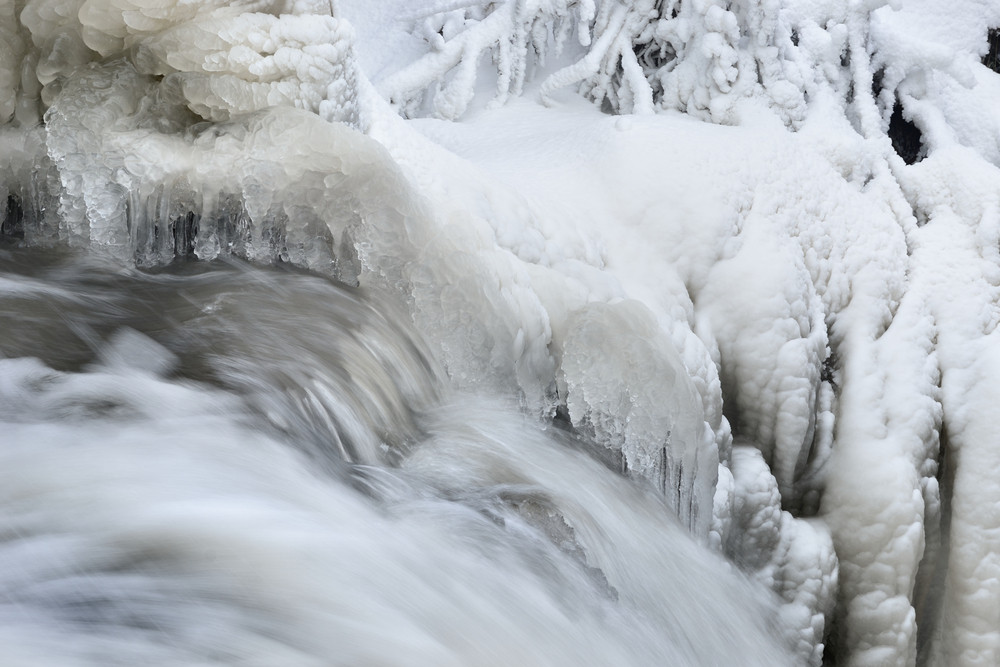 Waterfall In Winter With Beautiful Icicles