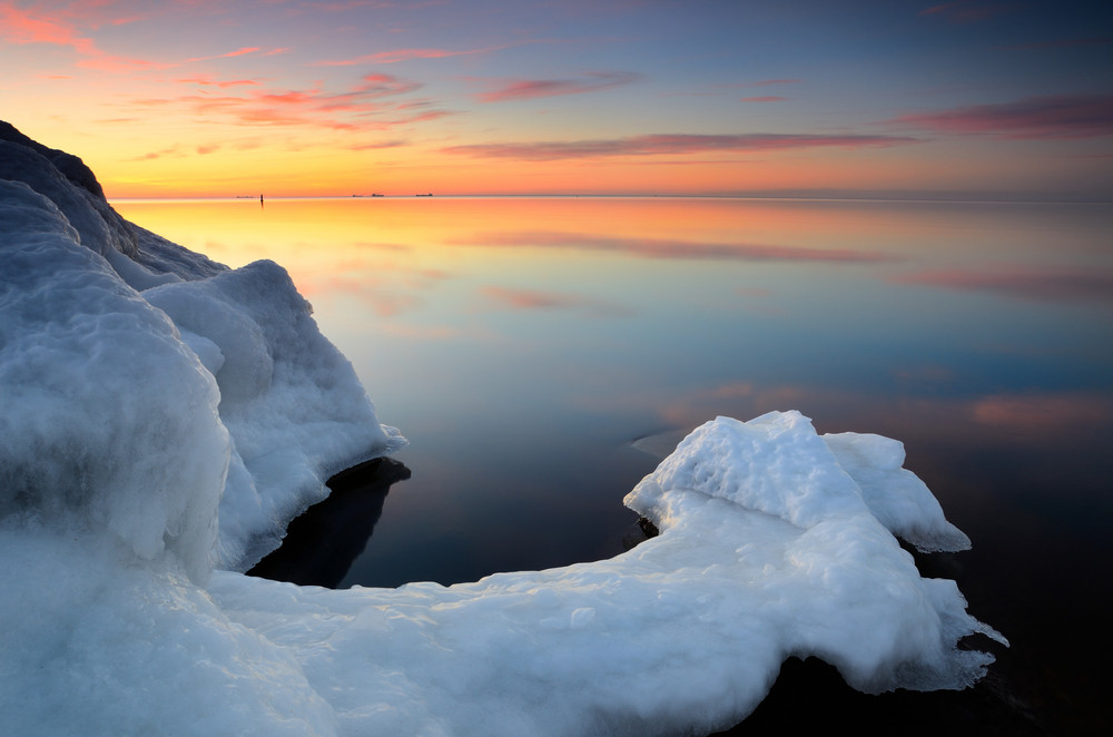 Baltic Sea Shore In Snowy Winter At The Sunset