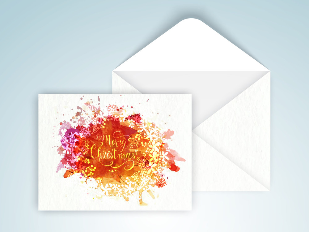 Beautiful floral design and colorful splash decorated greeting card with glossy envelope for Merry Christmas celebration.