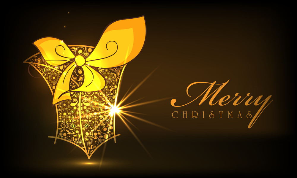 Floral decorated shiny gift box in golden color on brown background for Merry Christmas celebrations.