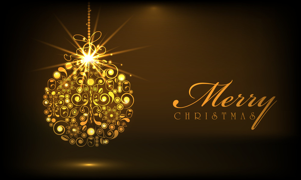 Shiny golden Xmas ball decorated with floral design for Merry Christmas celebrations on brown background.