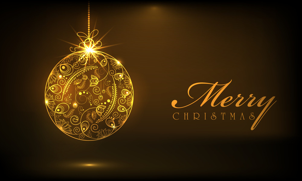 Beautiful floral decorated shiny Xmas ball in golden color for Merry Christmas celebrations on brown background.