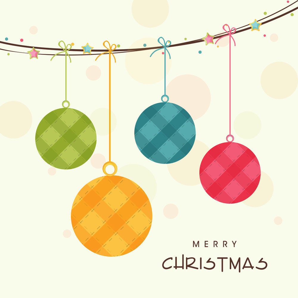 Hanging colorful Xmas ball for Merry Christmas celebration on beige background.