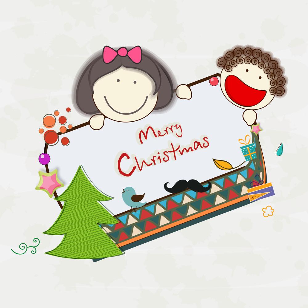 Little cute kids holding Merry Christmas celebration board on beige background.